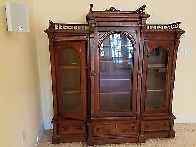 Antique Eastlake circa 1870's Walnut with Burl wood bookcase, 3 glass doors