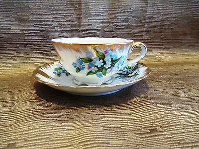 Handpainted Tea Cup and Saucer, Blue flowers with gold accents