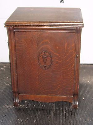 New Royal Antique Treadle Sewing Machine in a Parlor Cabinet