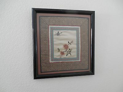 Framed Chinese embroidery of a flower and a butterfly