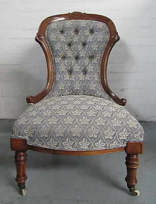 Beautiful Antique Upholstered Chair with Castors