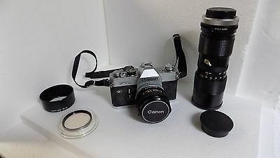 Vintage Canon 35mm Camera with Additional Lens