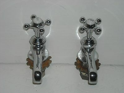 Pair of antique chromed brass faucets.