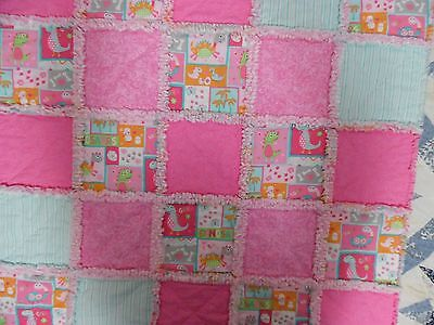 Pink And Aqua Baby Girl Rag Quilt With Dinosaurs