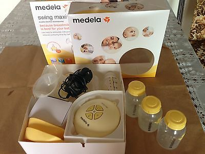 Medela Swing Maxi Double Electric Breast Pump +Store and Feed Set +Extra bottles