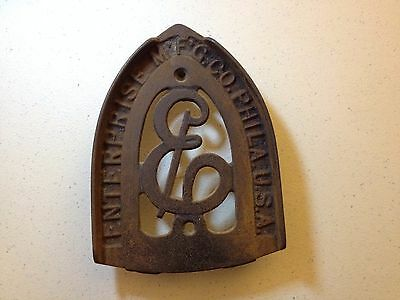 "Vintage Enterprise Mfg. Co. ""E"" Footed Sad Iron Trivet Philadelphia U.S.A."