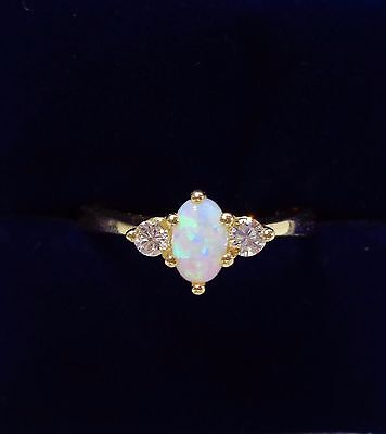 Three stone Opal and diamond ring in 9ct yellow gold