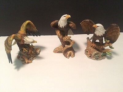 """Set of 3 Eagle Porcelain Figurines on Log Perches One Figure Holds Fish 9""""H Trio"""