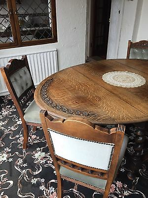 Antique oak dining chairs. Set of four.