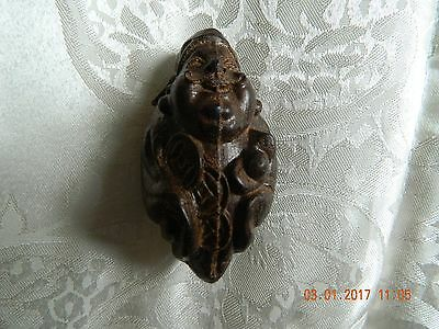 Oriental carved nut? Thought to be of a Buddha? Chinese?