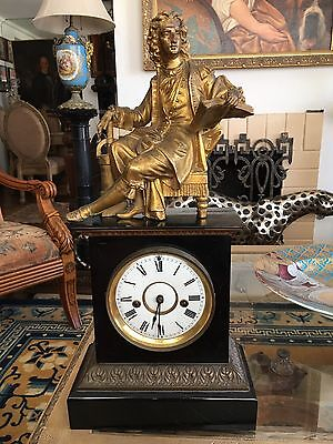 Antique French Gilt Ebony Mantle Clock With Bronze Statue