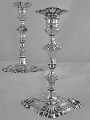 A  Pair Of Matching English, Early Georgian, Cast Sterling Silver Candlesticks