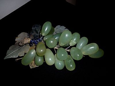 An Antique Bunch Of Carved Jade Grapes With Hardstone Leaves
