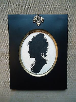 Silhouette Of  A  Girl  In An Acorn  Frame