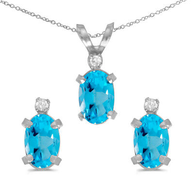 Sterling Silver Oval Blue Topaz and Diamond Earring and Pendant Set