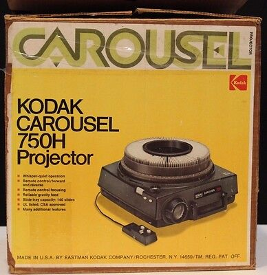 Kodak Carousel 750H Projector in original box with manual and remote.