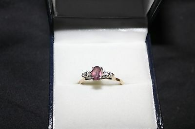 18ct yellow gold ring with Pink Stone and diamonds