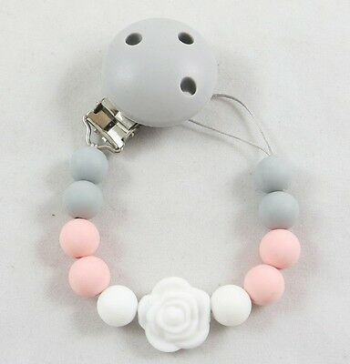 All Silicone clip and string paci pacifier holder clip girls boys teething toy