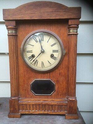 Oak cased late 19th century chiming mantle clock