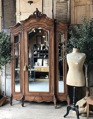 Original vintage French Louis XV Triple armoire with Mirrored doors