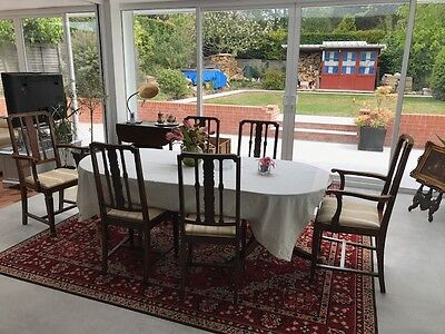 Antique mahogany dining table & six matching chairs