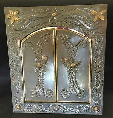 Beautiful Vintage Mexican punched tin tri-fold mirror with two doors.