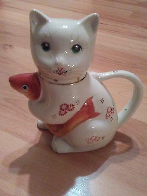 Ceramic, collectible, White Cat holding orange Koi fish teapot