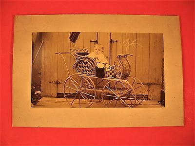 1C.1900 Cabinet photo of  baby in ornate Victorian wicker carriage 4-1/2 x 7-1/2