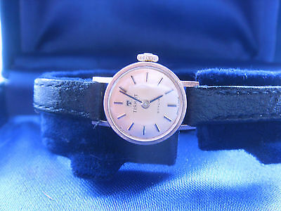 Ladies 9ct gold Tissot watch with black leather strap