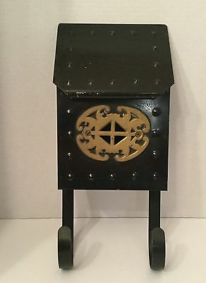 Vintage porch mail box.  Black finished metal with ornate brass plate.