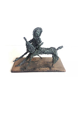 Mid Century Modern brutalist cowboy and bull resin and wood sculpture vintage re