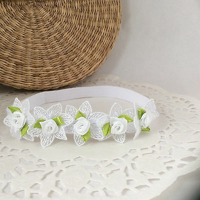 Christening baby headband, five white flowers with roses with leaves handmade UK