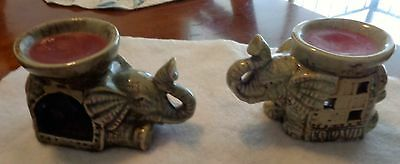 Set Of Two Ceramic Elephants With Scented Candles In Their Backpacks