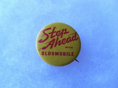 "Vintage ""Step Ahead With Oldsmobile"" Advertising Button by Whitehead & Hoag Co."