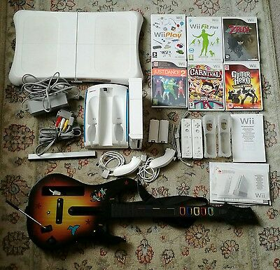 Pre-owned Nintendo Wii White Console  bundle with balance board and guitar