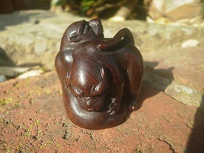 Hand Carved iron wood netsuke puppy dogs playing together, antique style figure