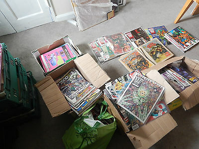 8 boxes of 2000ad programes ,megazines and other 2000ad year book