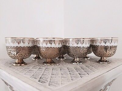 19C Kuznetsov (Russian) 8 porcelain coffee cups with silver cup holders