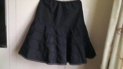 Vintage,petticoat.Navy blue.Stiff material with underneath netting.Size 10-12.