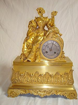 Gilt French Bronze Clock from early 1800 with a Girl and flowers