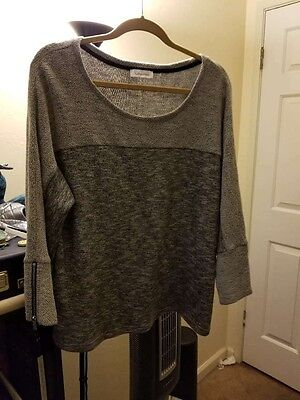 Calvin Klein woman's sweater, grey with zipper detail on the sleeve. Size L