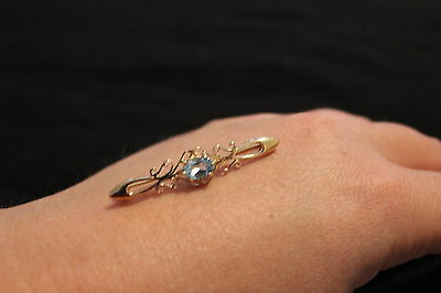9ct Yellow Gold and Blue Topaz Brooch