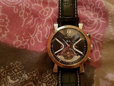 Forsining black and rose gold automatic watch. leather strap. open movement