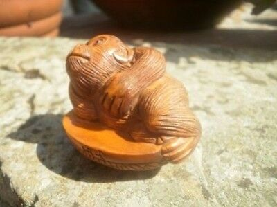 Hand carved wood netsuke baby Gorilla laying down, vintage or antique style