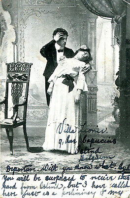 1903 sweetheart postcard Lady swooning in man's arms