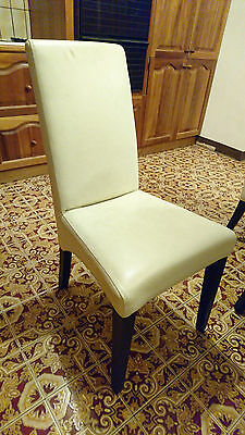 8 x modern Genuine Leather dining chairs. Used.
