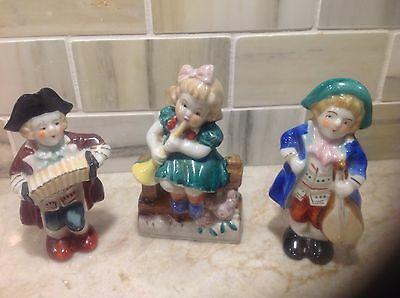 Set of three vintage figurines playing instruments made in Occupied Japan