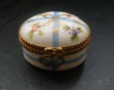 Limoges enamel trinket box-floral decoration with bow clasp