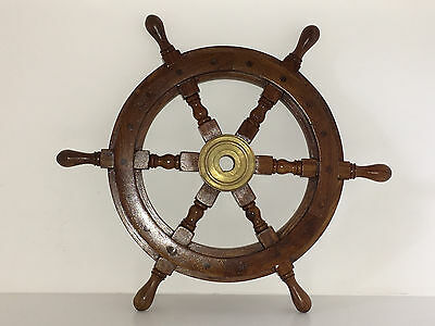 Wood and Brass Ships Wheel in traditional style.