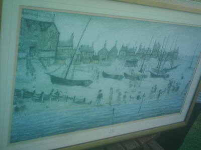 a picture ( print ) of the beach by l.s lowry